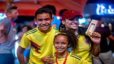 Colombian fans cheer on their team