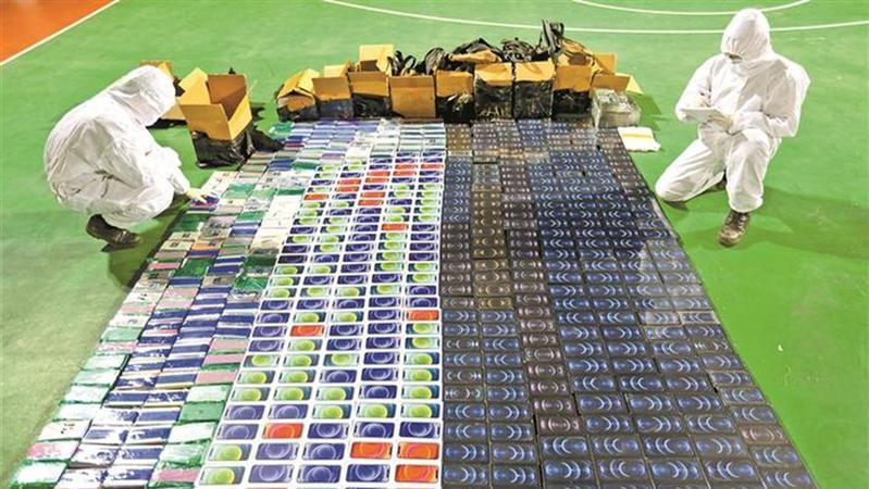 一根绳索运送上千部手机,半山腰地道转移货物……广东武警破获特大跨境走私案